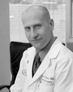James A. Olson, MD
